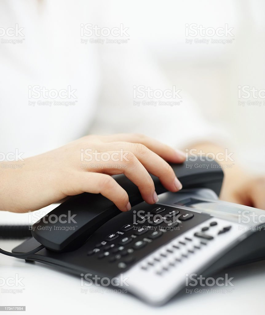 Human hand holding telephone receiver stock photo