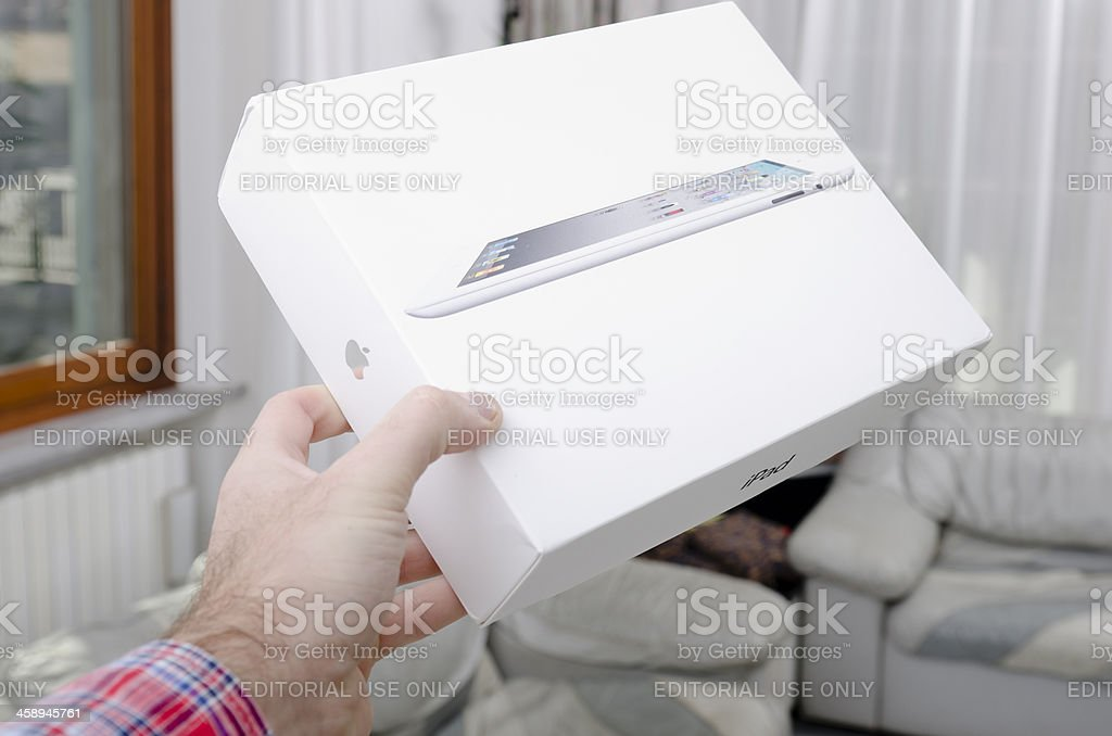 Human hand holding the new Apple Ipad 2 white case royalty-free stock photo