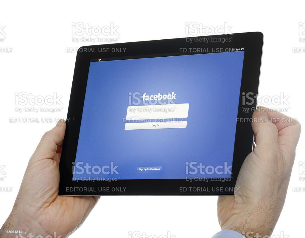 Human hand holding the new Ipad 3 with Facebook app royalty-free stock photo