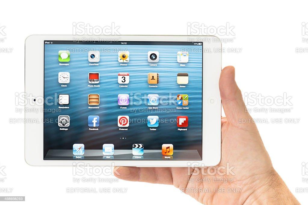 Human hand holding the new Ipad Mini royalty-free stock photo
