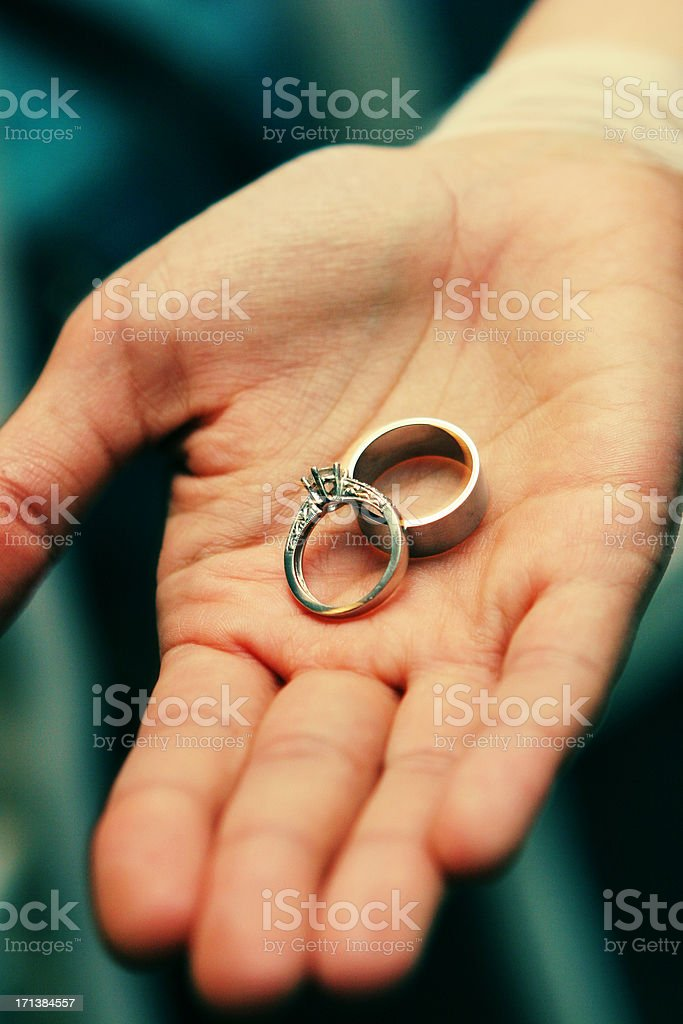 Human Hand Holding Two Beautiful Elegant Wedding Rings In Palm ...