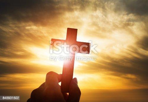 istock Human hand holding wooden cross 845931502