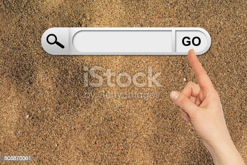 Human hand indicates the search bar in browser. Yellow sand surface on background