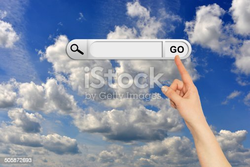 Human hand indicates the search bar in browser. Blue sky and clouds on background