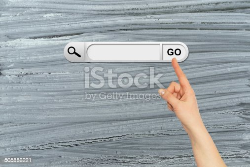 Human hand indicates the search bar in browser. Old and rough painted surface on background