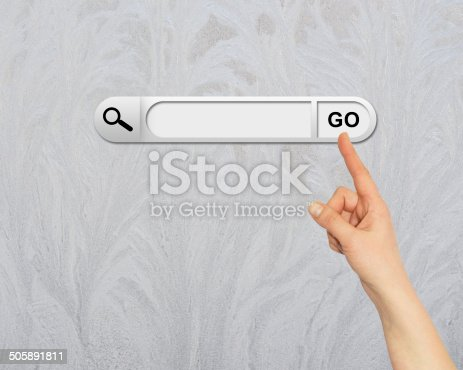 Human hand indicates the search bar in browser. Frost on glass as backdrop