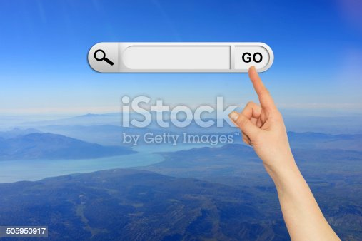 Human hand indicates the search bar in browser. Mountain, river and sky on background