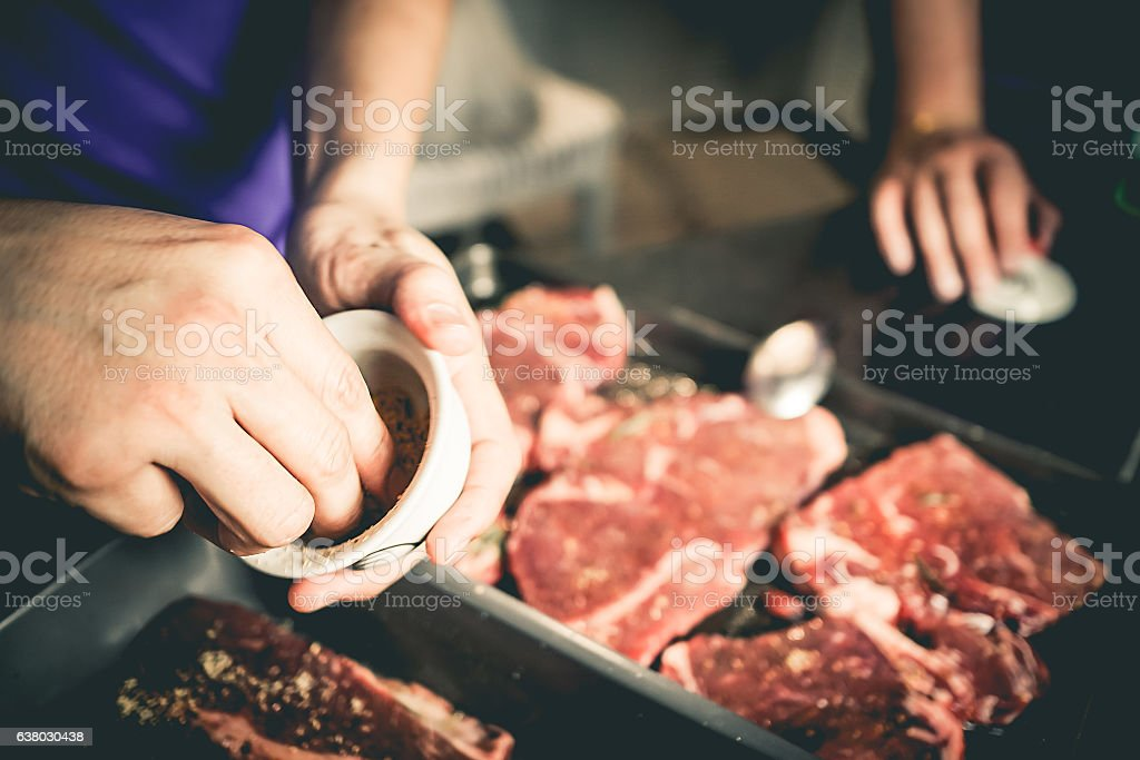 Human hand is preparing BBQ steak for party.​​​ foto