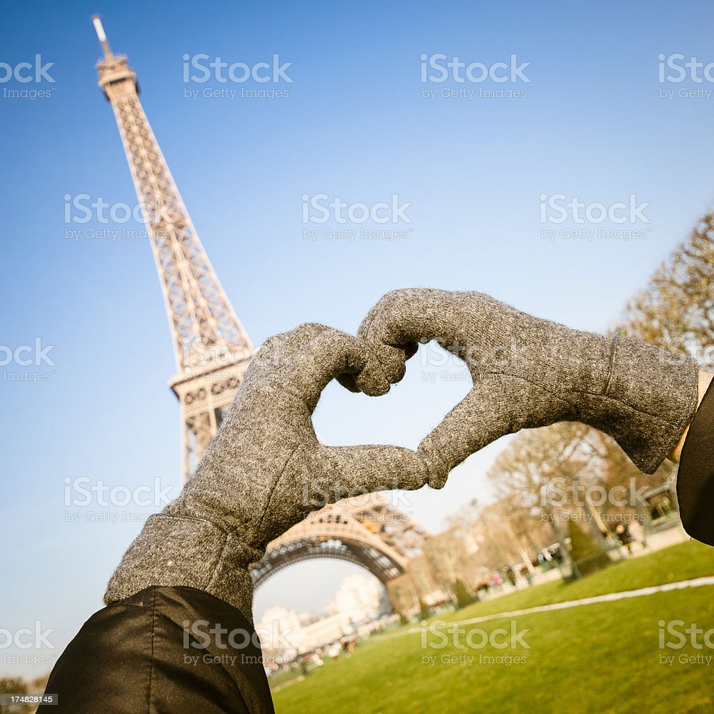 Human hand Love shape in paris under the Tour Eiffel royalty-free stock photo