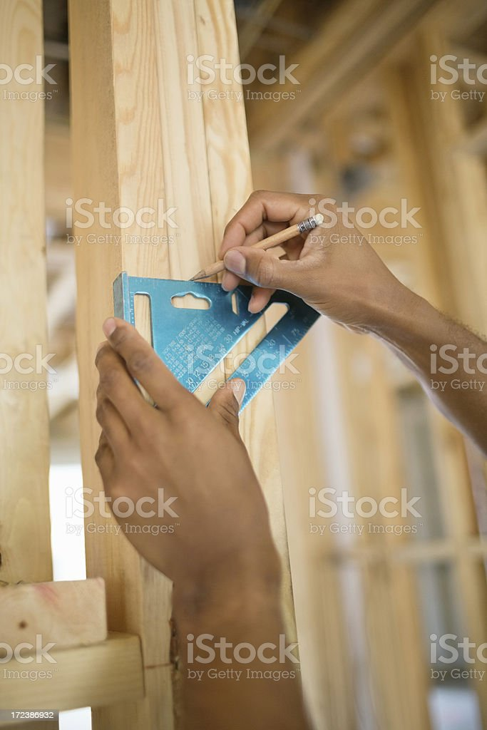 Human Hand Marking Wood Using Set Square At Site royalty-free stock photo
