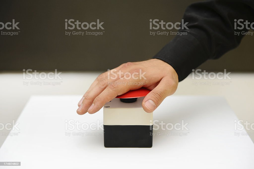 human hand on emergency alarm stock photo
