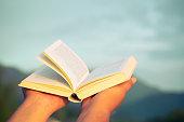 istock Human hand opens the bible 1283731358