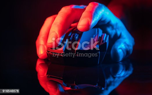 istock Human Hand over th High technology computer gaming mouse 916546578