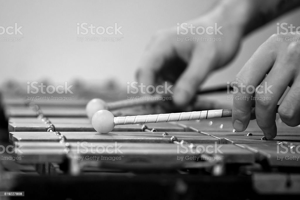 Human Hand playing the glockenspiel stock photo