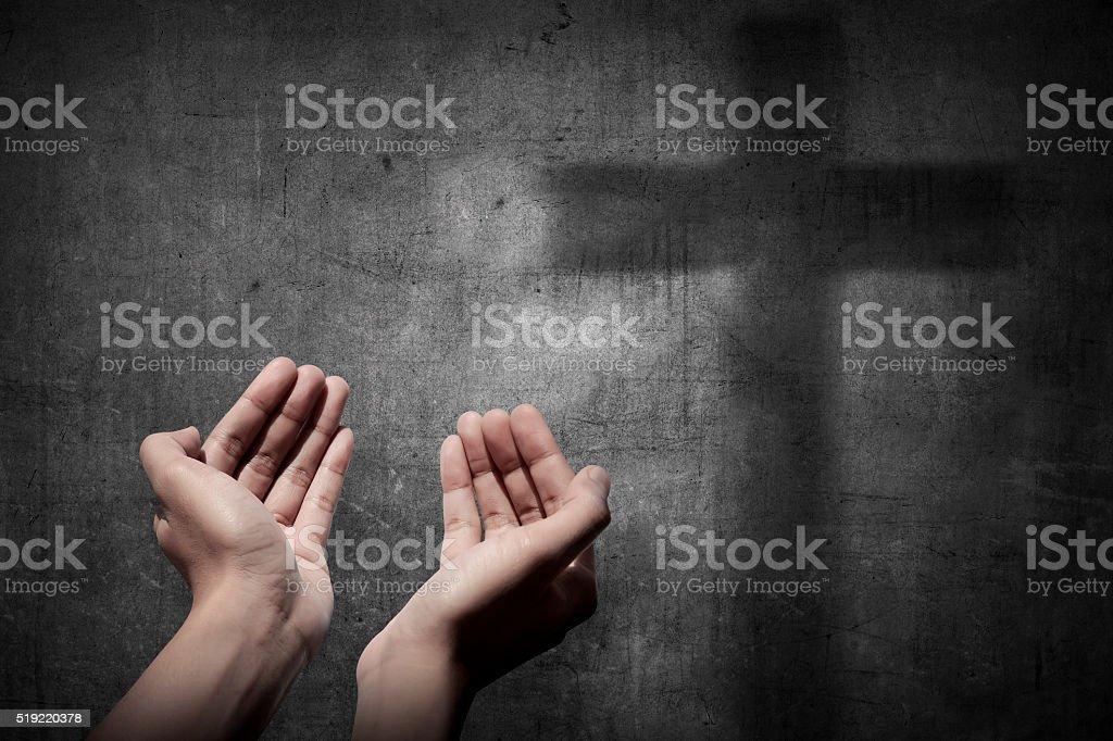 Human hand praying to god stock photo