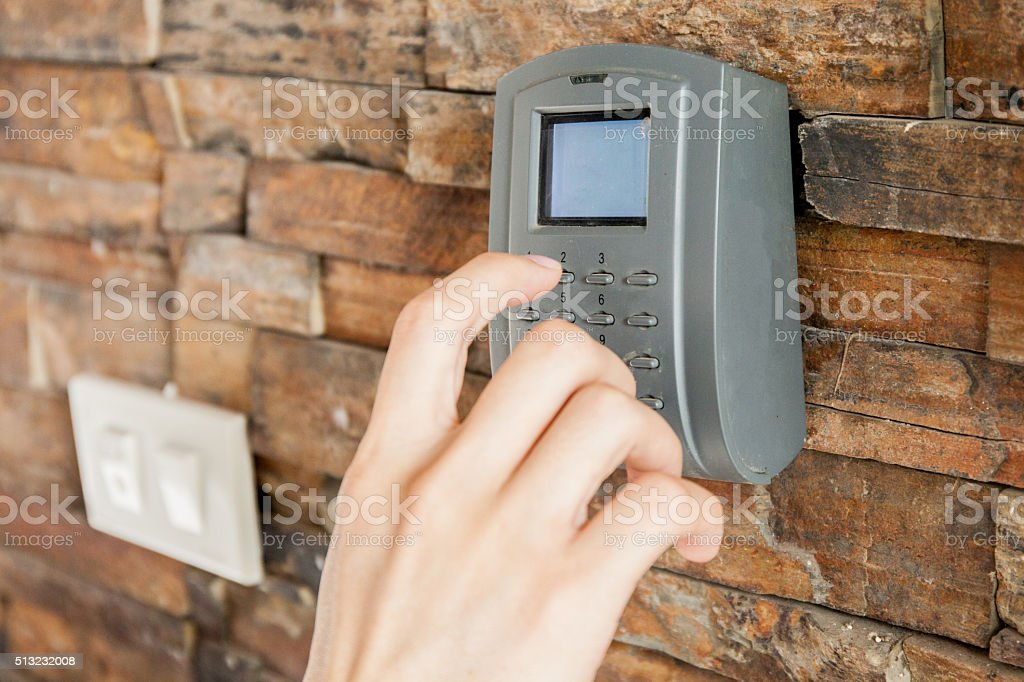 Human hand pressing on security combination code to unlock stock photo