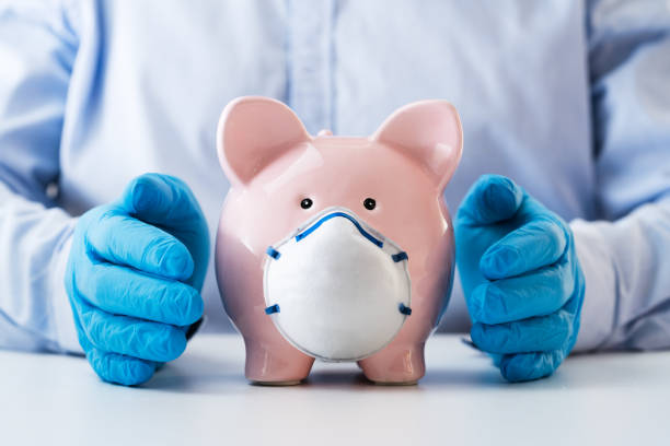 Human Hand Protecting Piggy Bank stock photo