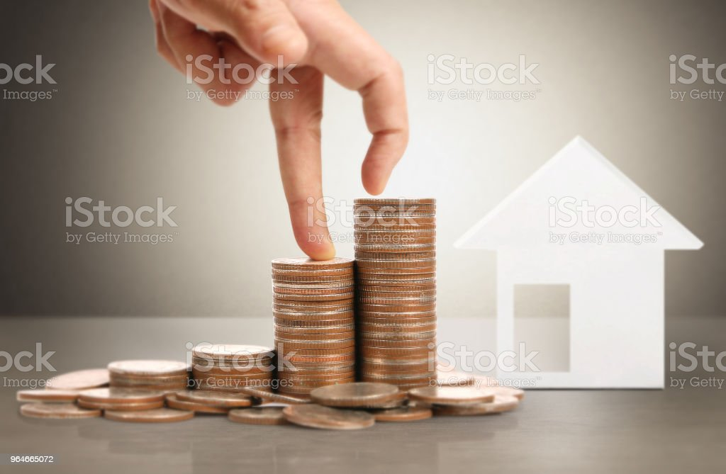human hand putting coin to money royalty-free stock photo