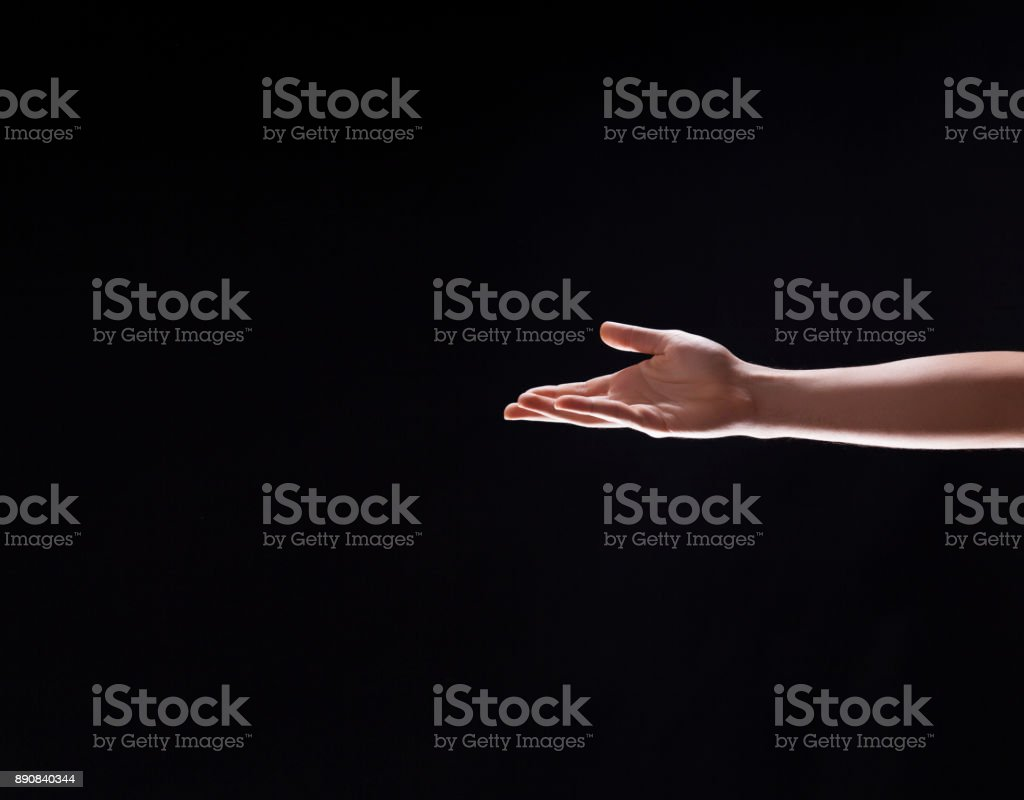 Human Hand Reaches Out to Help stock photo