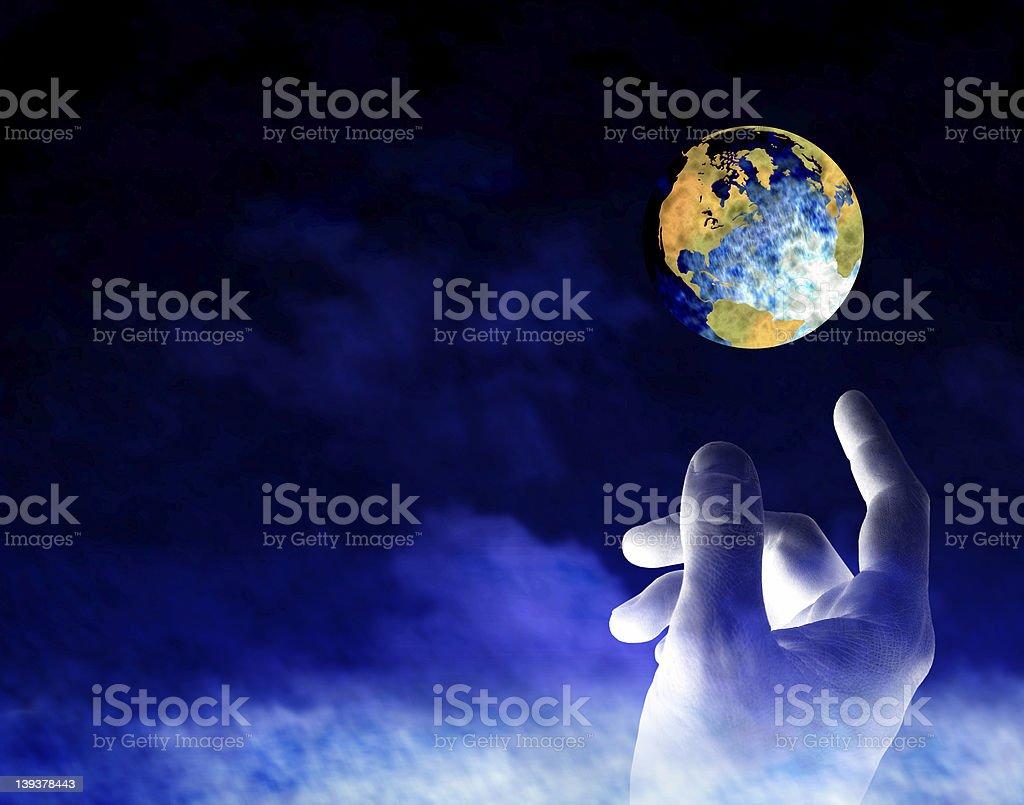 Human hand reaching towards the earth symbolizing creation stock photo