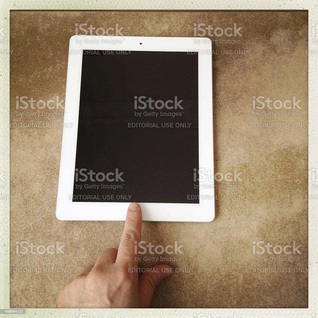 Human hand scrolling the new ipad 3 stock photo