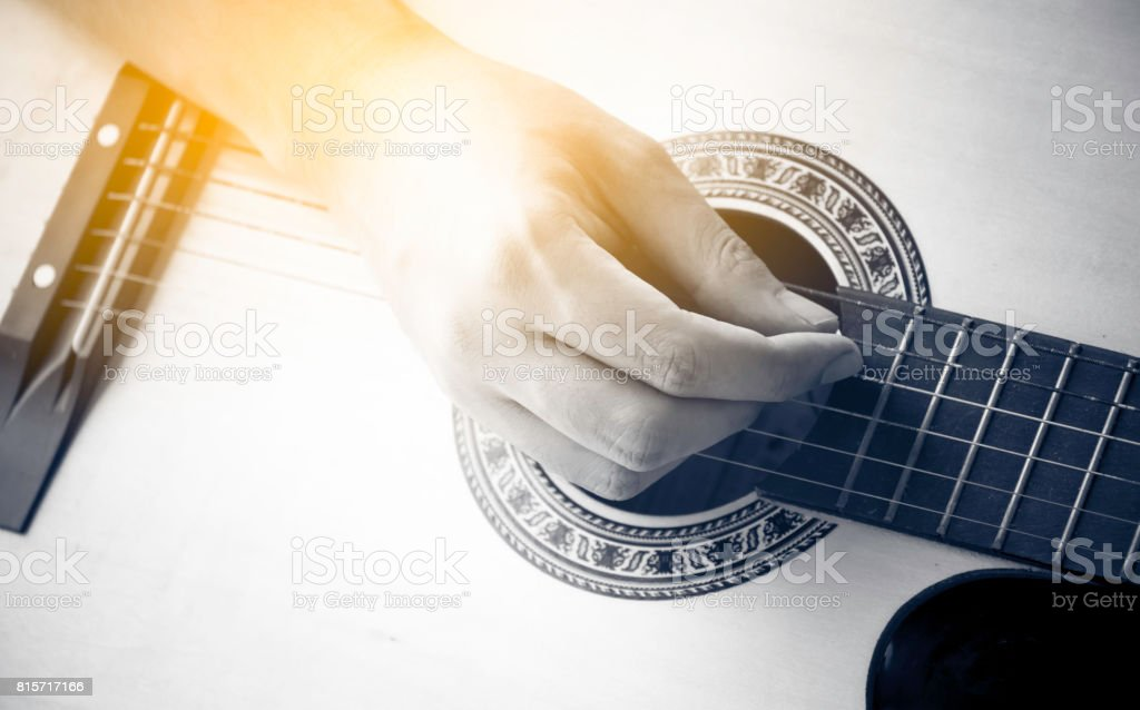 human hand show playing guitar stock photo