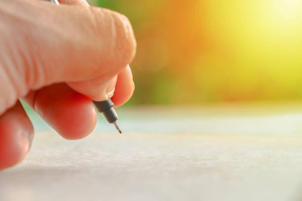 Human hand showing write something on book – Foto