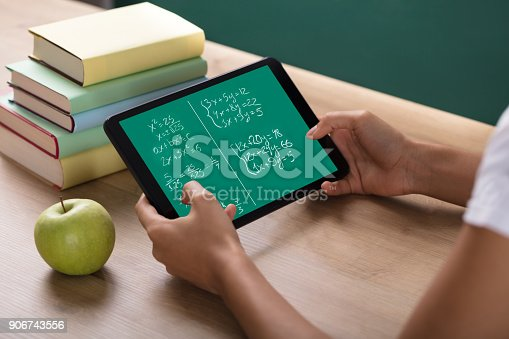 istock Human Hand Solving Math Problems On Digital Tablet 906743556