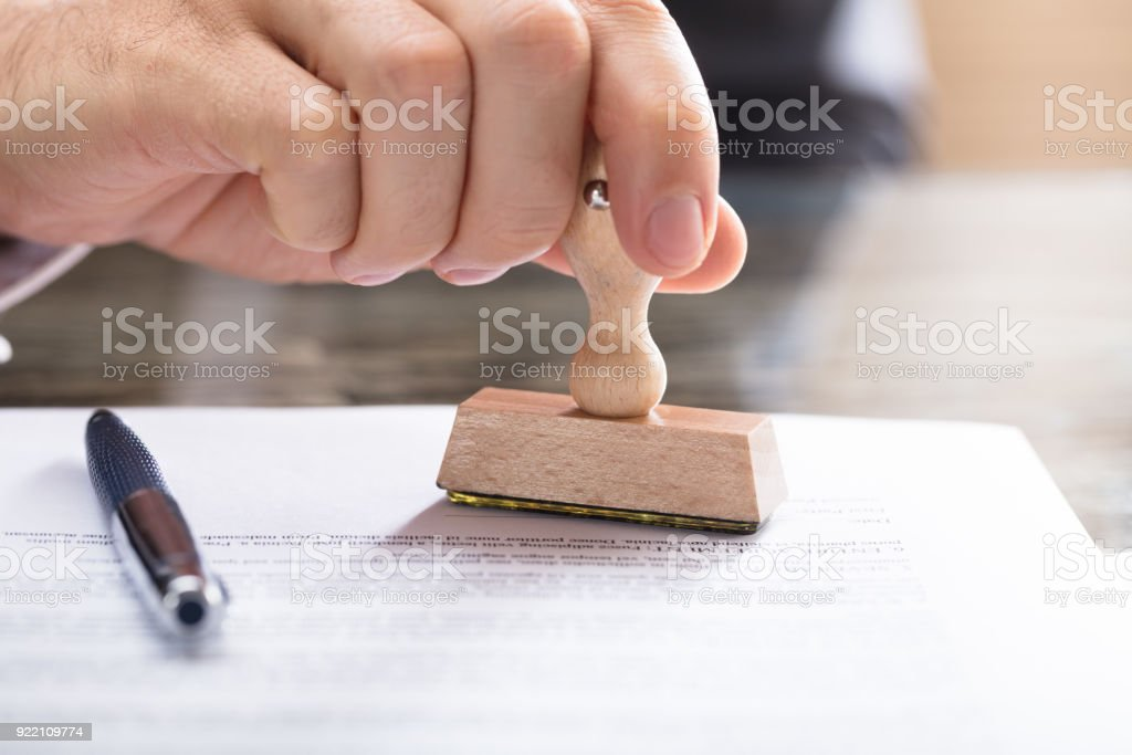 Human Hand Stamping Document stock photo