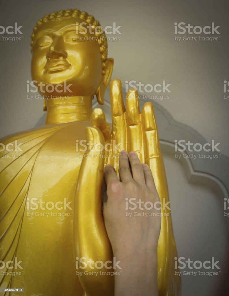 human hand touching buhda royalty-free stock photo