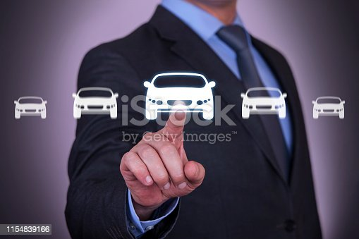 istock Human Hand Touching Car Button on Screen 1154839166