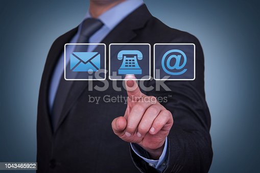 istock Human Hand Touching Contact Us on Visual Screen 1043465922
