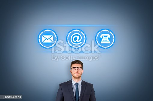 istock Human Hand Touching Contact Us on Visual Screen 1133439474