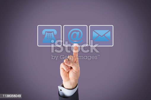 istock Human Hand Touching Contact Us on Visual Screen 1138058049
