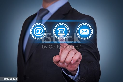 istock Human Hand Touching Contact Us on Visual Screen 1156326803