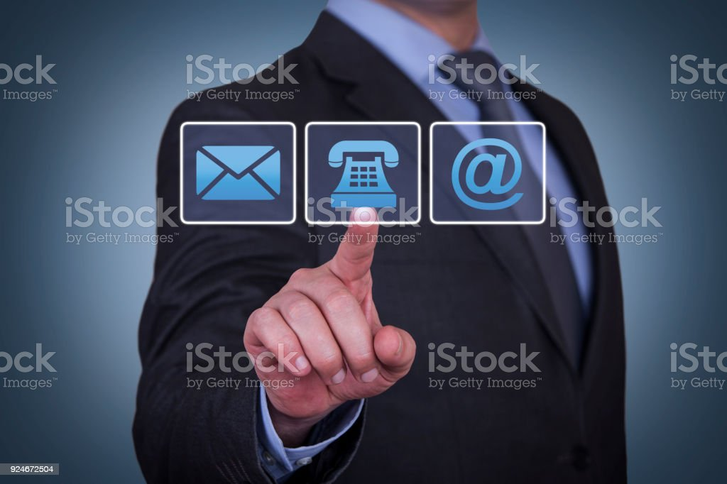 Human Hand Touching Contact Us on Visual Screen stock photo