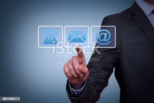 istock Human Hand Touching Contact Us on Visual Screen 984588014