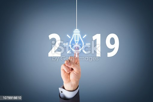 1069595584 istock photo Human Hand Touching New Year 2019 Idea Concepts on Visual Screen 1079916610