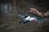istock human hand trying to reach,  on  concrete floor. Drugs addiction and withdrawal symptoms concept. drugsInternational Day against Drug Abuse. 1146220001