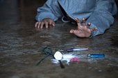 istock human hand trying to reach,  on  concrete floor. Drugs addiction and withdrawal symptoms concept. drugsInternational Day against Drug Abuse. 1146220117