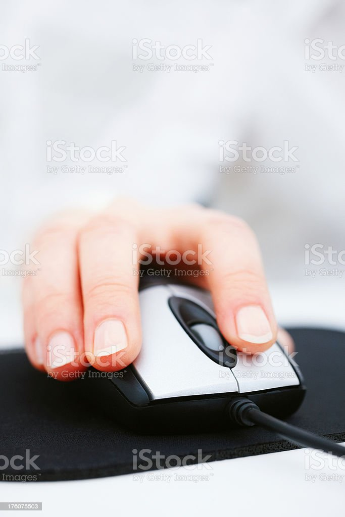 Human hand using a mouse royalty-free stock photo