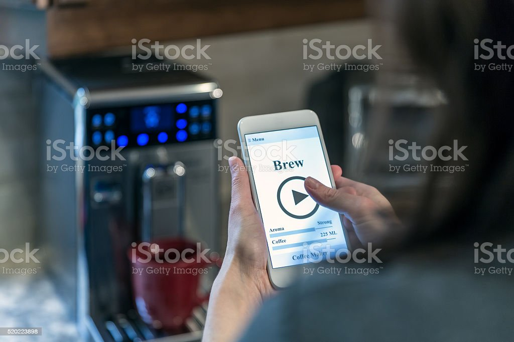 Human Hand Using Application on Mobile Phone, Smart Homes stock photo