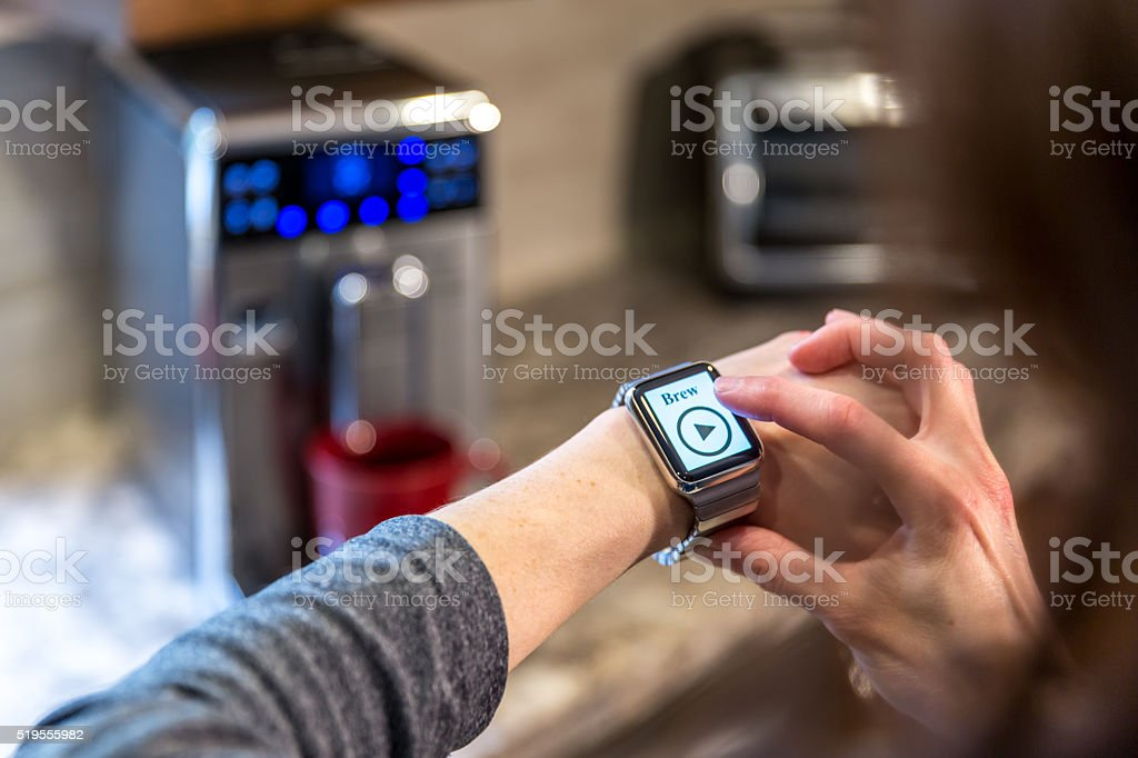 Human Hand Using Application on Smartwatch, Smart Homes stock photo