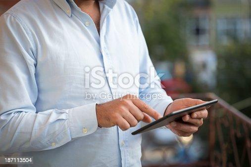 istock Human hand using tablet 187113504