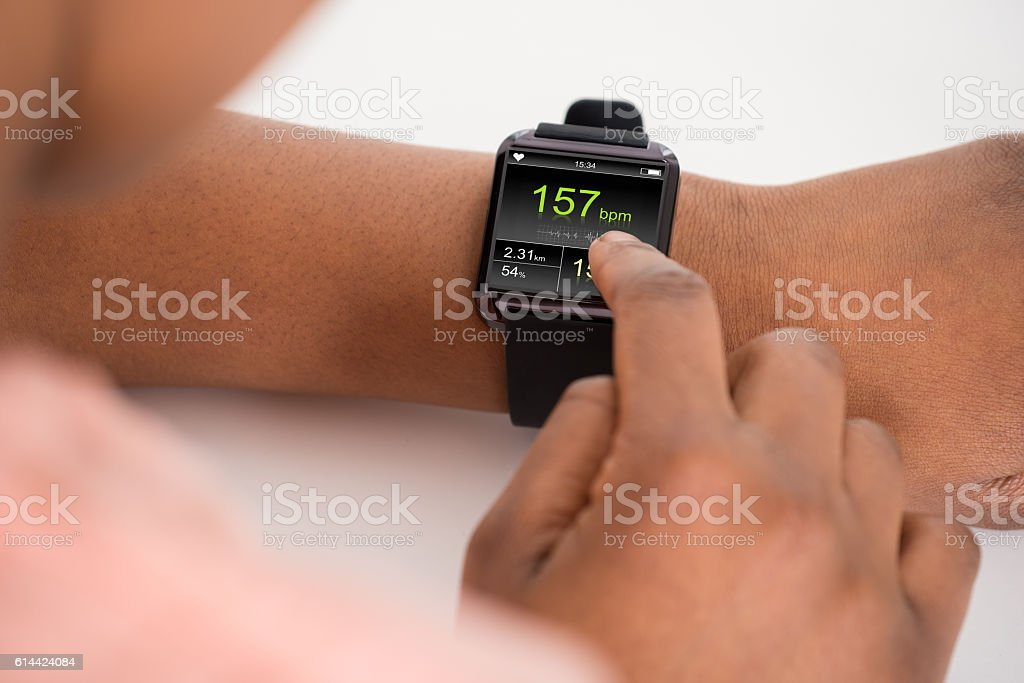 Human Hand Wearing Smartwatch Showing Heartbeat Rate stock photo