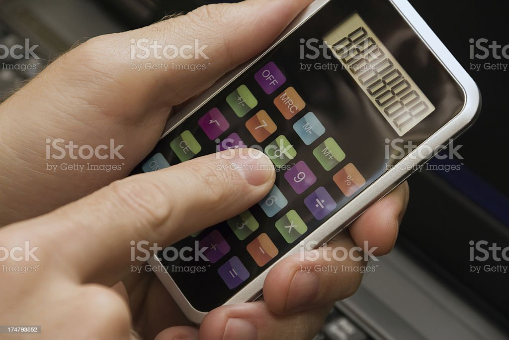 human hand with a calculator royalty-free stock photo