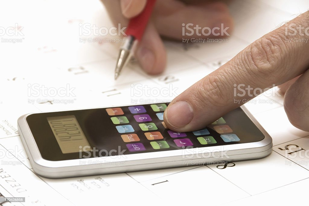 human hand with calculator and pen royalty-free stock photo