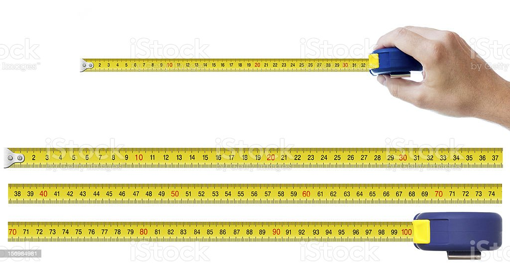 human hand with tape-measure and set of pieces stock photo