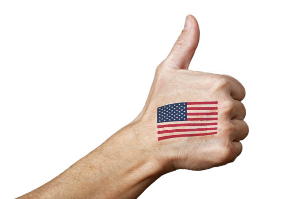 Human hand with thumb up gesture and USA flag Human hand with a painted or tattooed American flag showing thumb up sign. Isolated on white. american flag tattoos for men stock pictures, royalty-free photos & images