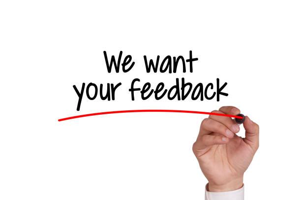 human hand writing we want your feedback on whiteboard - uwiedzenie zdjęcia i obrazy z banku zdjęć